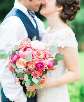 Colorful bouquet featuring coral peony, pink ranunculi, and Juliette garden roses.