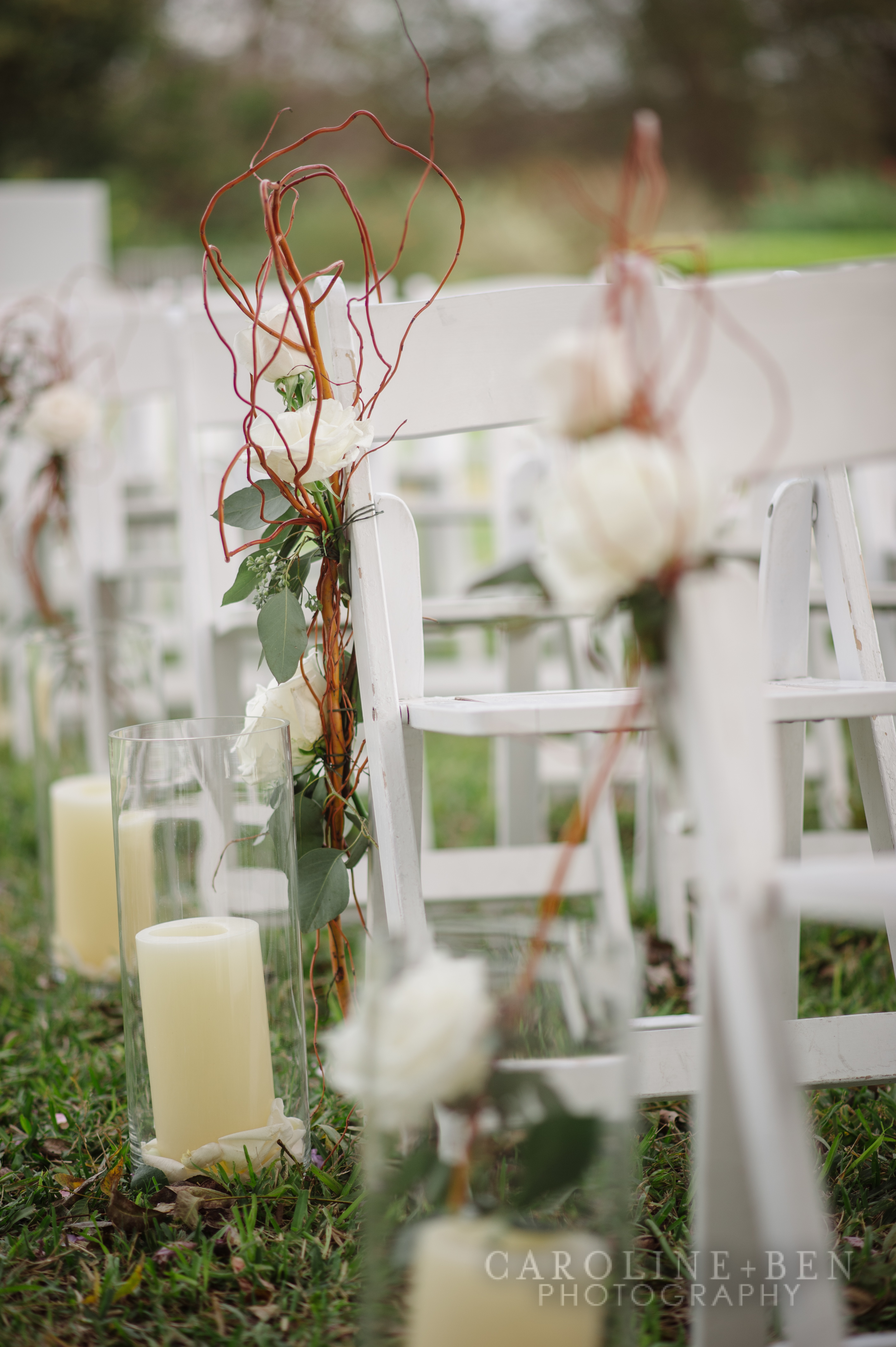 Candles, branches and flower accents for the aisle.