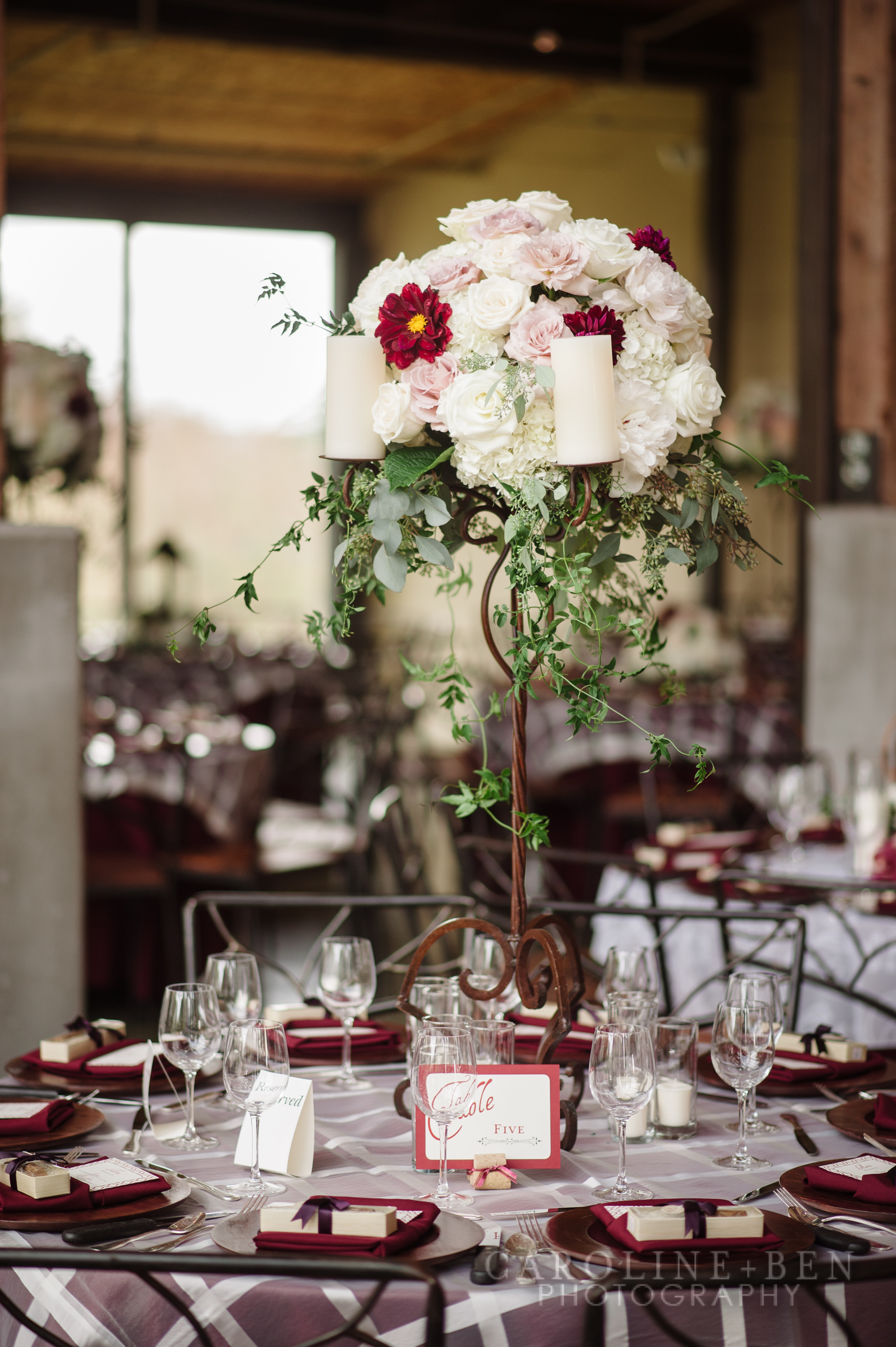 Tall candelabra-mostly white with a pop of crimson.