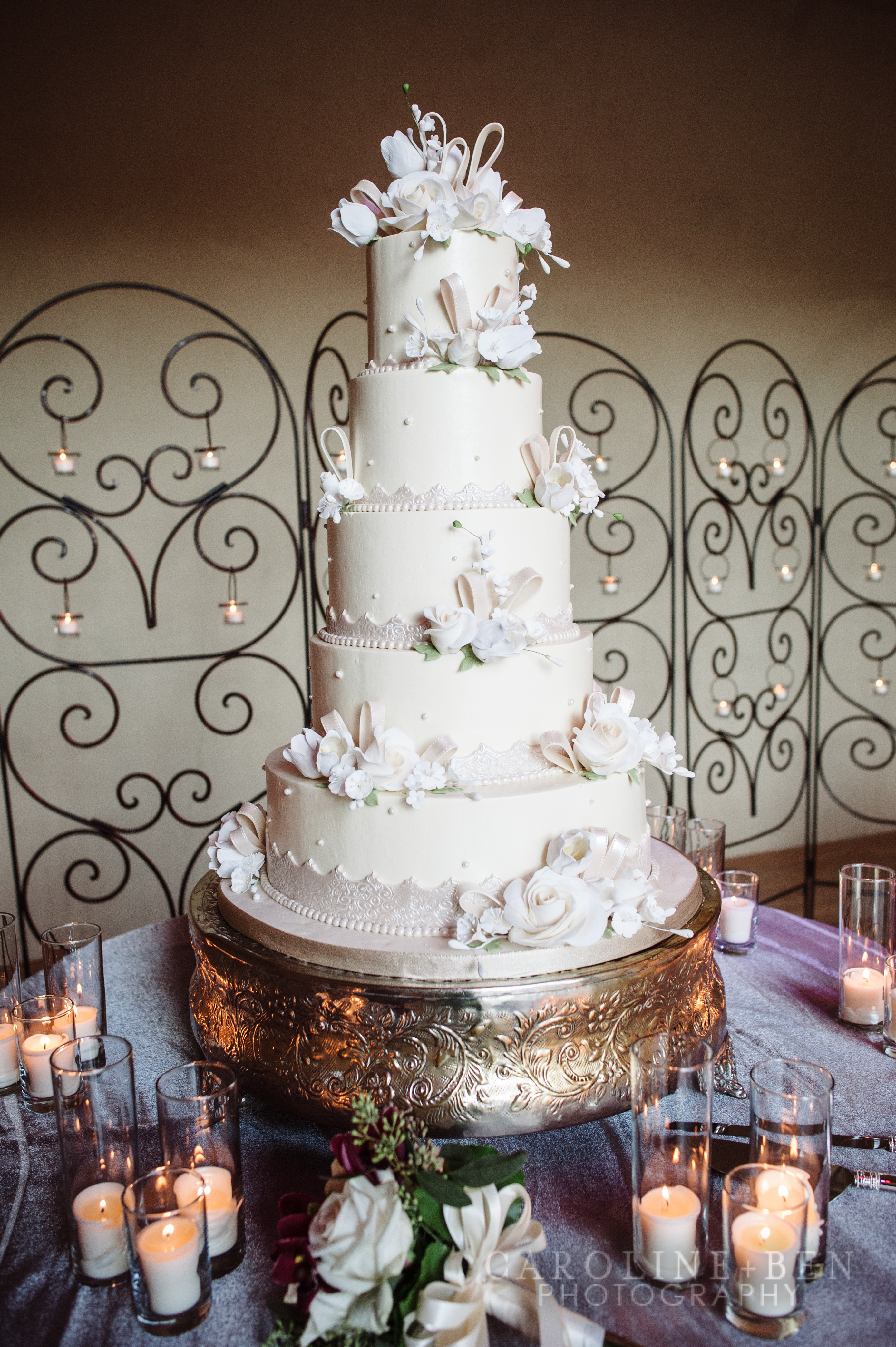 Stunning cake with candle backdrop.