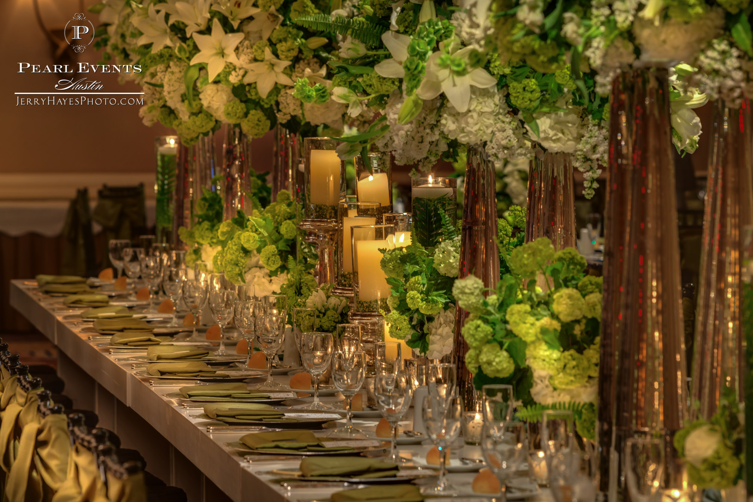 Organic green and white head table centerpiece.