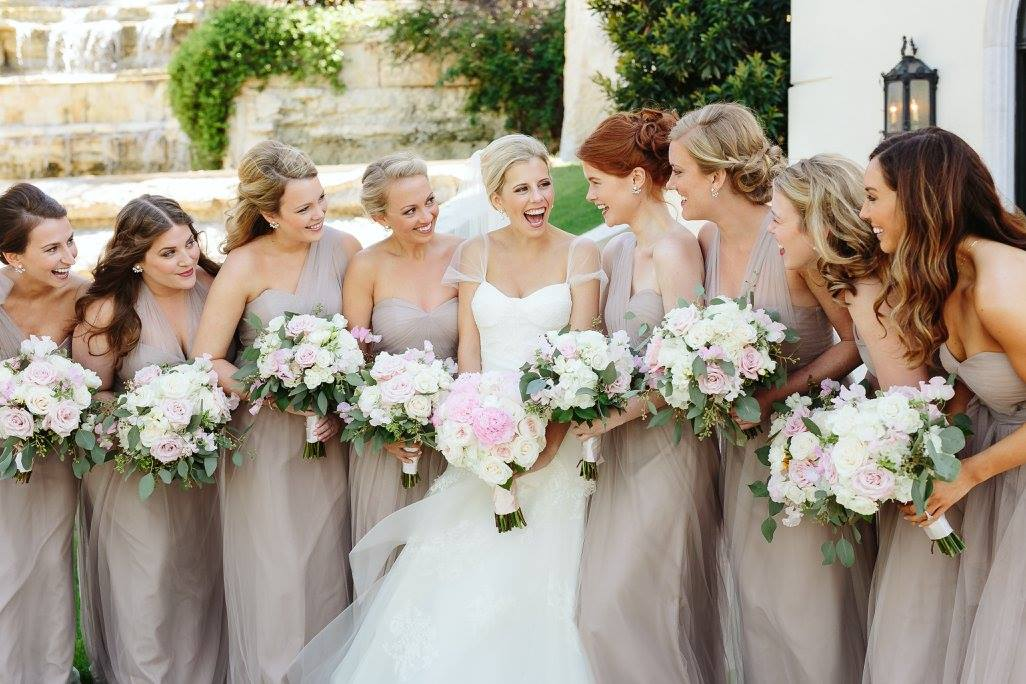 Peony and blush bouquets for neutral clad bridesmaids.