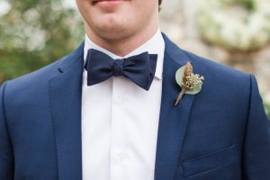 Feathers and berries for boutonniere.