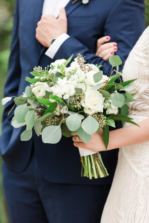 All white bridal bouquet for outdoor wedding.