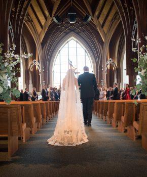 Bride and dad walking down the aisle at Emmaus Catholic Church