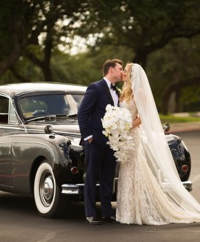 Antique car with bride and groom