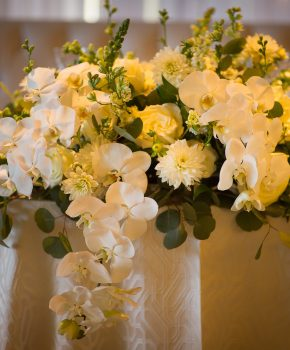 White blooms on sweetheart table.