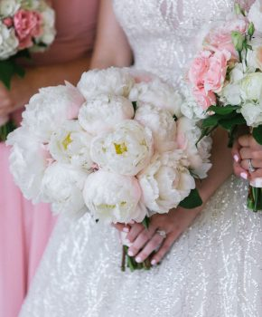 Bouquet of white peonies for bride.