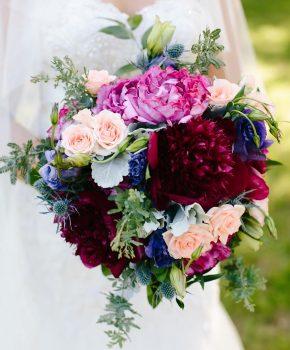 Rich jewel tone bridal bouquet- burgandy peony, fuschia garden roses and hints of purple.