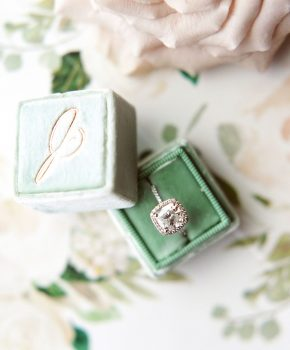 Sage green velvet box with engagement ring and monogram