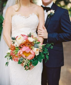 Summer bridal bouquet with shades of oranges and corals.