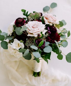 Fall wedding bouquet of blush and burgundy blooms with organic greenery.